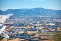 Aerial view from a plane of Mallorca, Spain. Aerial view from a plane of Mallorca with distant view of mountains Royalty Free Stock Photo