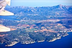 Aerial view from a plane of Mallorca, Spain. Aerial view from a plane of Mallorca with the mediterranean sea and distant mountains Stock Photos