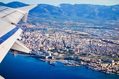 Aerial view from a plane of Mallorca, Spain. Aerial view from a plane of Mallorca with the mediterranean sea and distant view of Palma Royalty Free Stock Photos