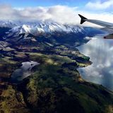 Aerial View from Plane of Mountain and Lake Landscape. Picture taken from from a plane overlooking snow capped mountains and lake arriving into Queenstown, New royalty free stock image