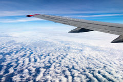 Aerial view plane. Aerial view out of window of plane which flies above the earth surface and above clouds Stock Images