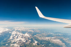 Aerial view from the plane. Aerial view from a plane that is over the the mountains in Switzerland Stock Photography