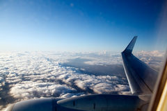 Aerial view with plane wing above clouds Stock Photo
