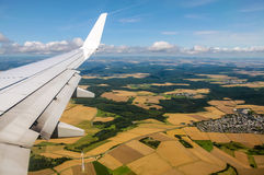 Aerial view of plane wing and fields Stock Photos