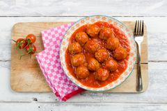 Aerial view of a plate meatballs in tomato sauce. 