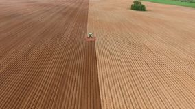 Farmer seeding, sowing crops at field. royalty free stock photo