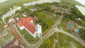 Aerial view Poblacion city with catholic church in the Philippines. Anda. Aerial view Poblacion city with catholic church in the Philippines. Anda stock video footage