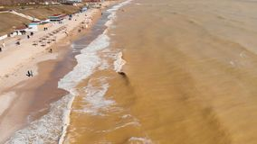 Aerial view of the polluted sea coast. Muddy sea water. Chemical disaster. Drone. Aerial view of clay-polluted sea coast. Muddy sea water. Environmental stock video footage