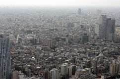 Aerial view of poluted modern city. Wrapped in smog Stock Image