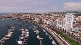 Aerial view Ponta Delgada from marina, Sao Miguel, Azores, Portugal. Yachts along the port piers. A view on Ponta Delgada from marina, Sao Miguel, Azores stock footage
