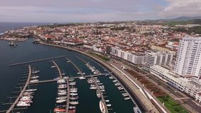 Aerial view Ponta Delgada from marina, Sao Miguel, Azores, Portugal. Yachts along the port piers. A view on Ponta Delgada from marina, Sao Miguel, Azores stock video footage