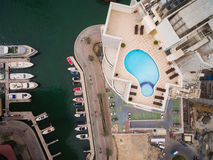 Aerial view of pool of water on the roof of a skyscraper in Dubai, UAE Royalty Free Stock Images