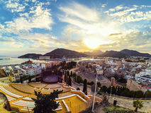 Aerial view of port city Cartagena in Spain. Cartagena, Spain. Aerial view of port city Cartagena in Spain with famous roman amphitheater. Beautiful sunset over stock photo