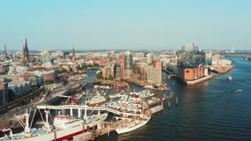 Aerial view of the port of Hamburg and the city of Hamburg on a nice fine day with a clear cloudless sky during before stock video footage