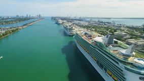 Miami aerial 360 view buildings boats Miami river and down town. Aerial view port of Miami and down town showing cruise ships buildings convention centers and stock video
