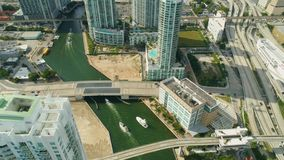 Miami aerial 360 view buildings boats Miami river and down town. Aerial view port of Miami and down town showing cruise ships buildings convention centers and stock footage