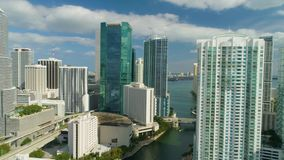Miami aerial view buildings boats Miami river and down town. Aerial view port of Miami and down town showing cruise ships buildings convention centers and arenas stock video