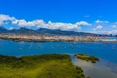 Aerial view of the port and mountains in Honolulu Hawaii. Aerial view of the port, marina and mountains in Honolulu Hawaii helicopter Stock Photo