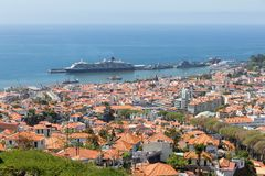 Aerial view of Portugese Funchal with a big cruise ship in the harbor Stock Photo