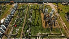 Electrical substation, power station. Aerial view. Aerial view power plant, transformation station, cables and wires. High voltage electric power substation stock video footage