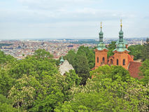 Aerial view of Prague, Czech Republic, with church St. Laurence in the foreground Royalty Free Stock Images