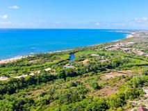 Aerial view of Praia do Forte, Bahia, Brazil coastline and tropical forest. Praia do Forte beach and coastal village in the Brazilian state of Bahia. travel royalty free stock photography