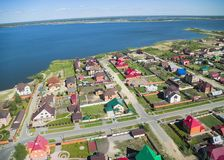 Aerial view on private houses on bank of lake. Bird's eye view onto rural street in Borovskiy village. Tyumen region. Russia Royalty Free Stock Photos