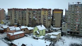 Aerial view of private houses residential area and high residential buildings in winter city. stock video