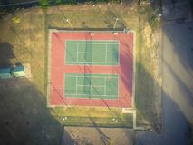 Aerial tennis court at public park in Ozark, Arkansas, USA. Aerial view public tennis court in rural Ozark, Arkansas, America at sunset. Top view outdoor court stock photography