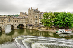 Aerial view of Pultney Bridge and Weir, Bath, England. Aerial view of Pultney Bridge and Weir on River Avon with boat in Bath, England in daylight with overcast Royalty Free Stock Photo
