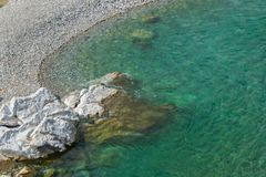 Aerial view of turquoise water and clean sea shore.Albania, Europe. Aerial view of pure turquoise water and clean sea shore.Albania, Europe royalty free stock photos