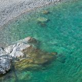 Aerial view of turquoise water and clean sea shore.Albania, Europe. Aerial view of pure turquoise water and clean sea shore.Albania, Europe stock image