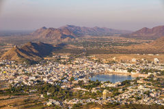 Aerial view of Pushkar, the town with the holy lake and the surrounding hills and rural landscape. Travel destination in Rajasthan Stock Photo