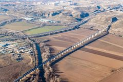 Aerial view of R3 motorway and a high speed rail. Near Madrid, Spain royalty free stock photography