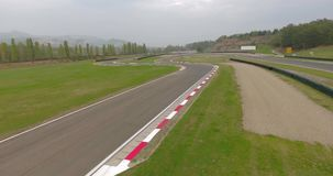 Race track aerial view. Aerial view of race track on a cloudy autumn day stock footage