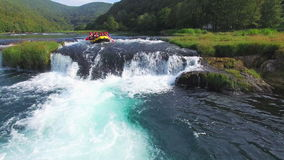 Aerial view of rafters approaching waterfall on Una river in Bosnia stock video footage