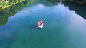 Aerial view of rafters paddling through still water of Una river in Bosnia stock footage