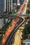 Aerial view of the rail road way sky train over Bangkok city. Scene with city light and bokeh, slow motion moment of train running royalty free stock photography