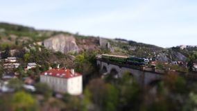 Aerial view - rail train miniature tilt shift lens effect time lapse. Aerial view - rail train miniature tilt shift lens effect time lapse stock footage