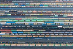 Aerial view of railroad tracks, cargo sorting station. Many different railway cars with cargo and raw materials.  royalty free stock photography