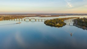 Aerial view on railway bridge above Dnieper river in Dnipro city. Aerial top view from drone on railway bridge above Dnieper river in Dnipro city. Autumn stock photos