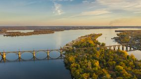 Aerial view on railway bridge above Monastic island and Dnieper. Aerial view from drone on railway bridge above Monastic island and Dnieper river in Dnipro city stock photography