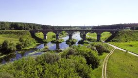 Aerial view of the railway bridge over the river stock video footage
