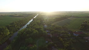 Aerial view of railway bridge over small water-channel, and beautiful crop fields. Sombor, Serbia. View of railway bridge over small water-channel, and stock video