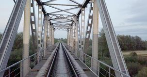 Aerial view on railway bridges over the river. Railroad. Heavy industry. Industrial conceptual scene. Metal construction. Of the railway bridge. Top view stock footage