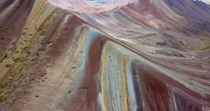 Aerial view of the Rainbow mountain and Andes peaks of Peru