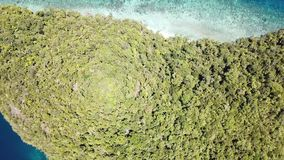 Aerial View of Raja Ampat Island Scenery. The amazing islands of Raja Ampat, Indonesia, are surrounded by healthy coral reefs. This tropical region is known as stock video footage