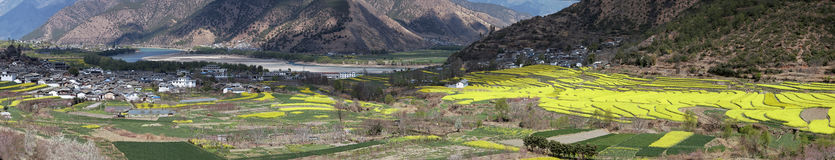 Aerial view of rapeseed flowers around ShiGu village near Lijiang . ShiGu is in Yunnan, China, and was part of the South Silk Road Stock Photography