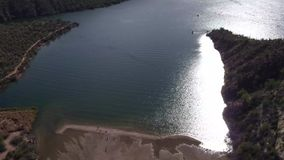 Aerial View - Recreation Site with Beach by Lake stock video footage