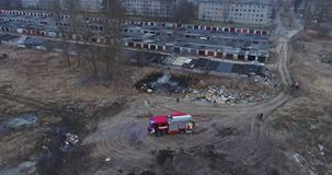 Aerial view of red fire truck with led light. Burning dump. stock video footage